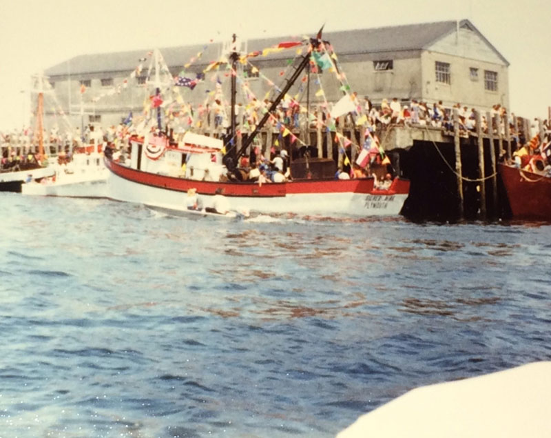 Blessing eileen white boat with red stripe at dock
